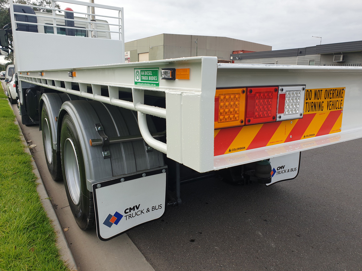 Volvo truck with flat tray and custom splash guards