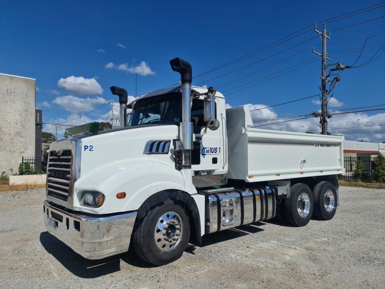 Mack truck with tipper truck body